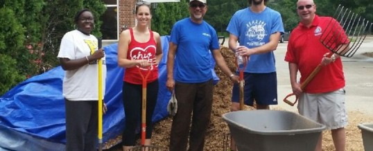 Rockwell Automation volunteers help prep playgrounds